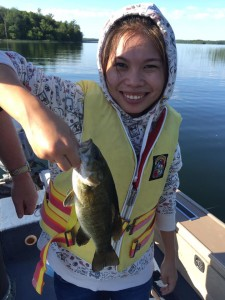 Viya catches her first fish in Minnesota.